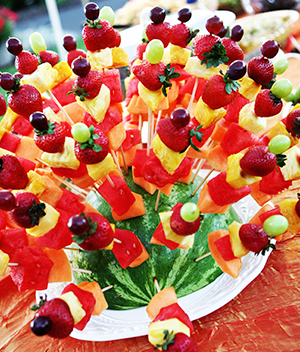 Beautifully decorated fresh fruit plater at a catered event